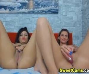 Two Lesbian Plays With Her Shaved Tight Pussy