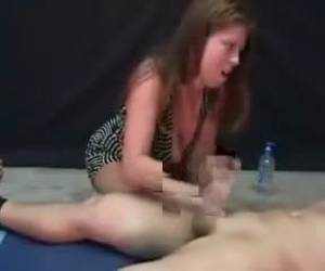 Busty Brunette Gives Her Man A Spectacular Handjob While Assuming Very Hot Poses