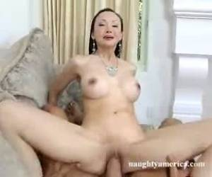 Mature Asian With Fake Tits Gets A Pounding.