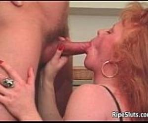 Slutty Mature Redhead Gets That Wet