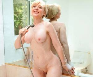 Busty Nina Hartley Masturbating In The Bathroom
