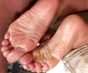 Debbie White Jerks Off Cock With Feet Getting Her Toes Sticky