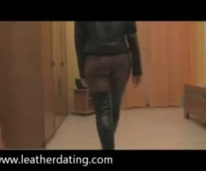 Brunette Walking Around In Leather Jacket, High Leather Boots And Brown Leather Pants